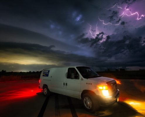 Service Van in front of stormy skies