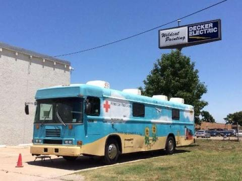 American Red Cross blood drive bus parked outside of Decker Electric's Wichita building