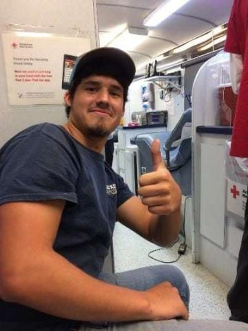 Photo of a Decker Electric team member donating blood in the American Red Cross bus