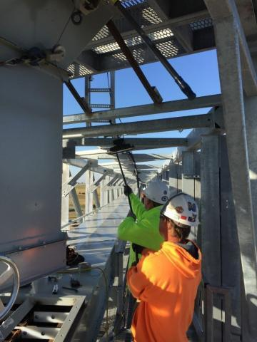 Image of 2 Decker Electric technicians working on a design build project in the midwest