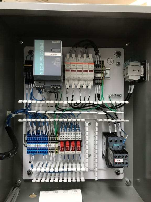 a photo of wiring inside a control panel