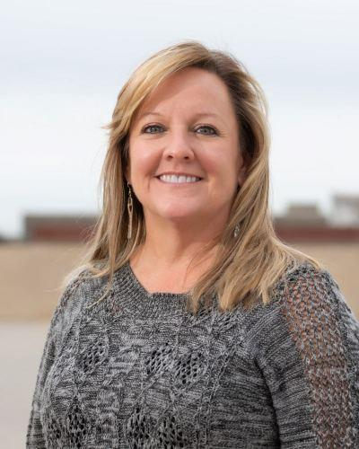 Photo of Kristi Christy who joined the company in 2012 and helps manage the day to day business operations for Decker Electric.