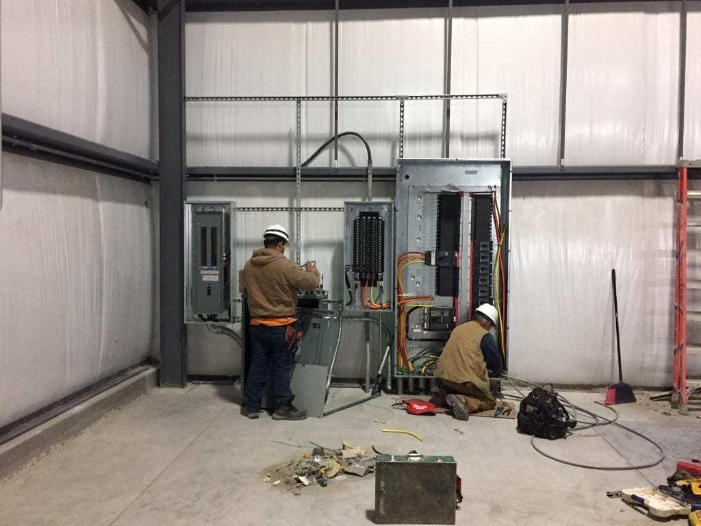 electricians working maybe warehouse - Machine Shops