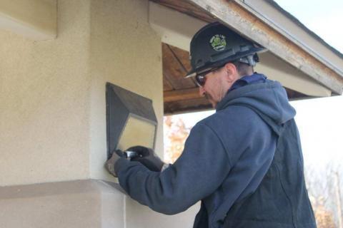 Decker technician installing outdoor lighting