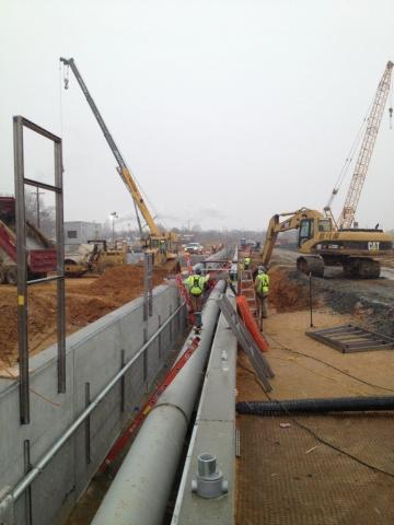 image of pipeline in Delaware of the DE Rail Unloading with Decker Electric staff