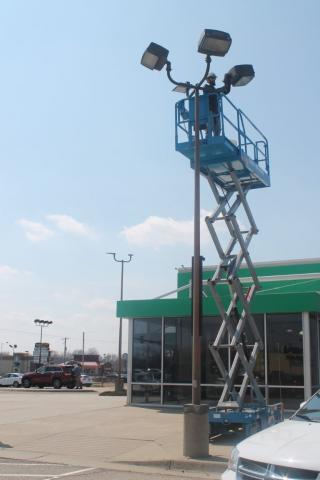 boom lift for Decker Electric electrician to work on parking lot lighting