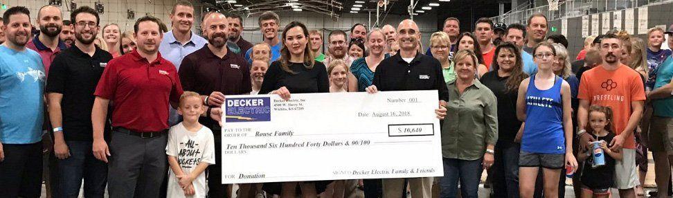 Decker Electric team donating money to Wichita family