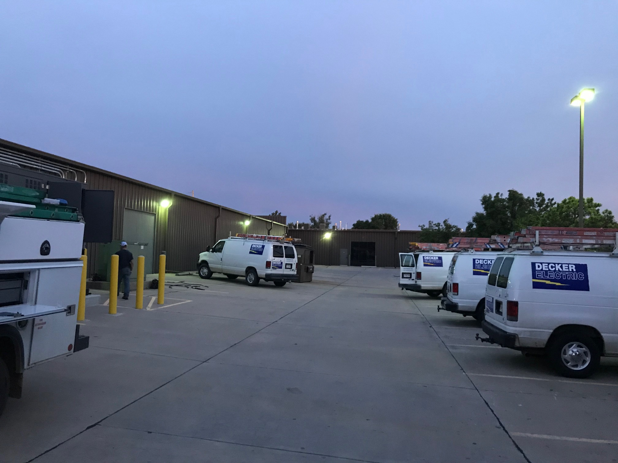 several Decker Electric vans sitting outside a local business in Wichita KS