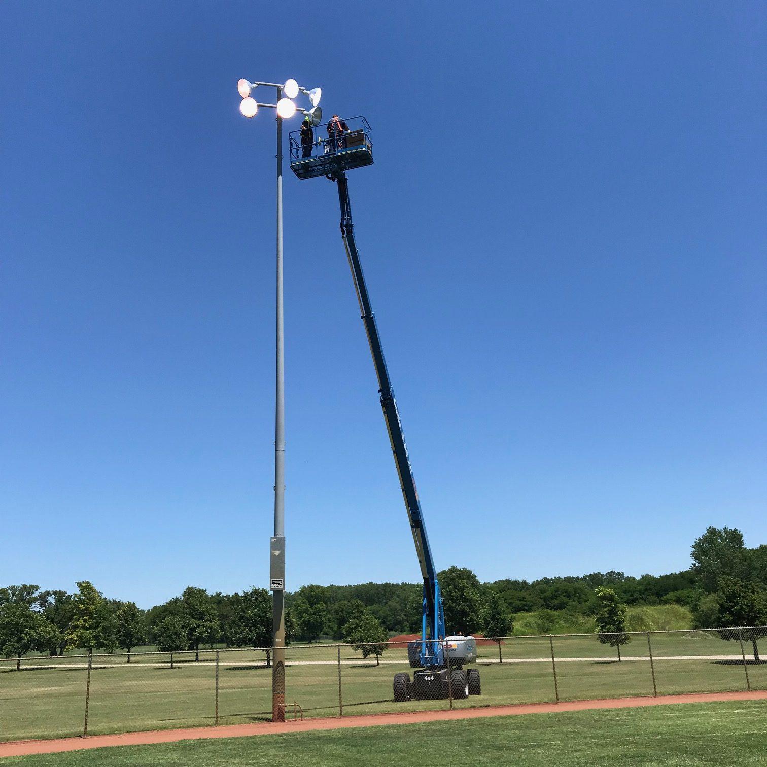 Decker Electric employee servicing City of Wichita outdoor lighting