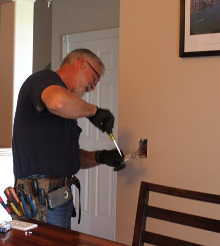 Electician fixing broken outlet 429x480 - Decker Electric Residential Electrical Service